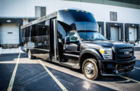 black dark tinted window limo bus tampa transportation