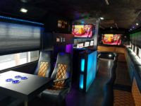 executive party limo bus bar tvs table business transportation