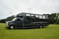 outside of tampa aparty bus black with dark tinted windows